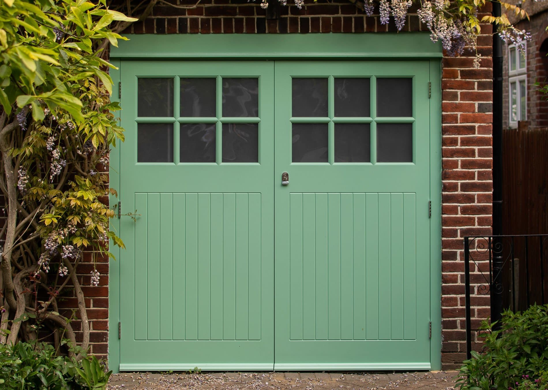 painted bespoke garage doors and frame. door have glass in the top part