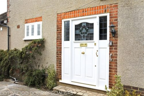 1920s Front entrance door with curved stained glass. Door fitted with brass locks and furniture