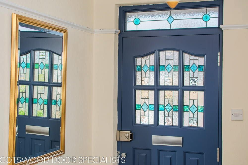 1930's Grey spray painted six light front door. Door with stained and leaded glass as double glazed unit. View from hallway with light shining though stained glass