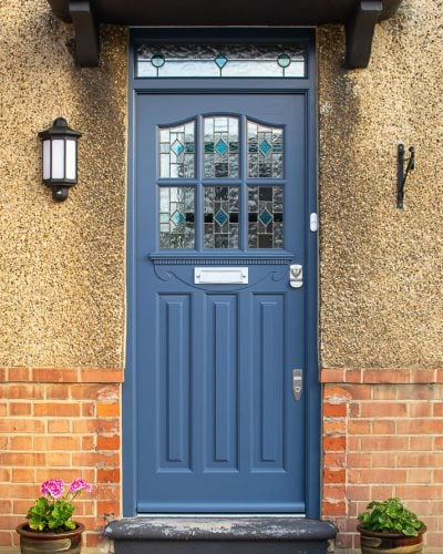1930's Grey spray painted six light front door. Door with stained and leaded glass as double glazed units. Door furniture satin chrome with banham locks