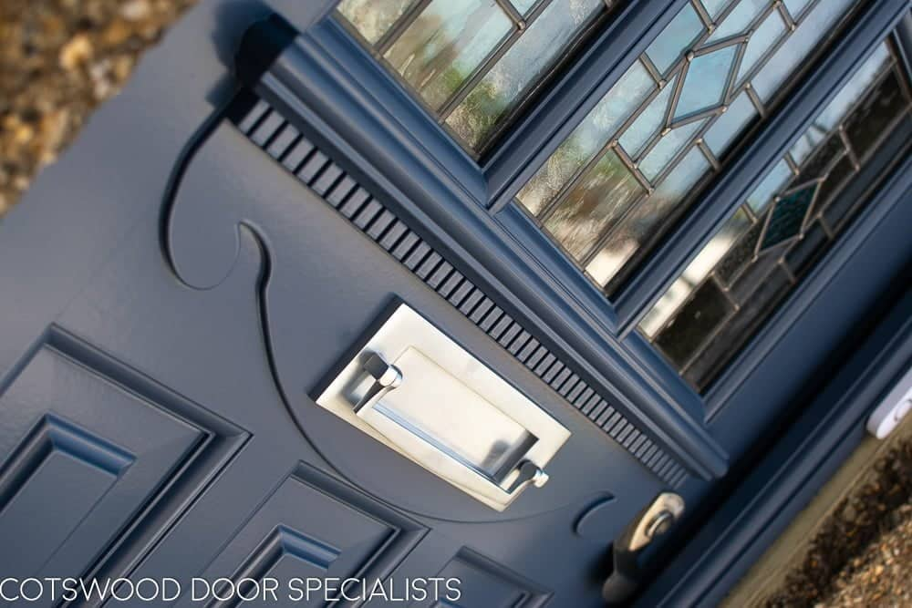 1930's Grey spray painted six light front door. Door with stained and leaded glass as double glazed units. Door furniture satin chrome with banham locks. Detail of decorative apron below glass on door
