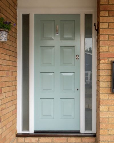 8 Panel front door fitted into sidelight frame