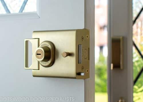 Satin brass banham door lock in bespoke 1930s front door