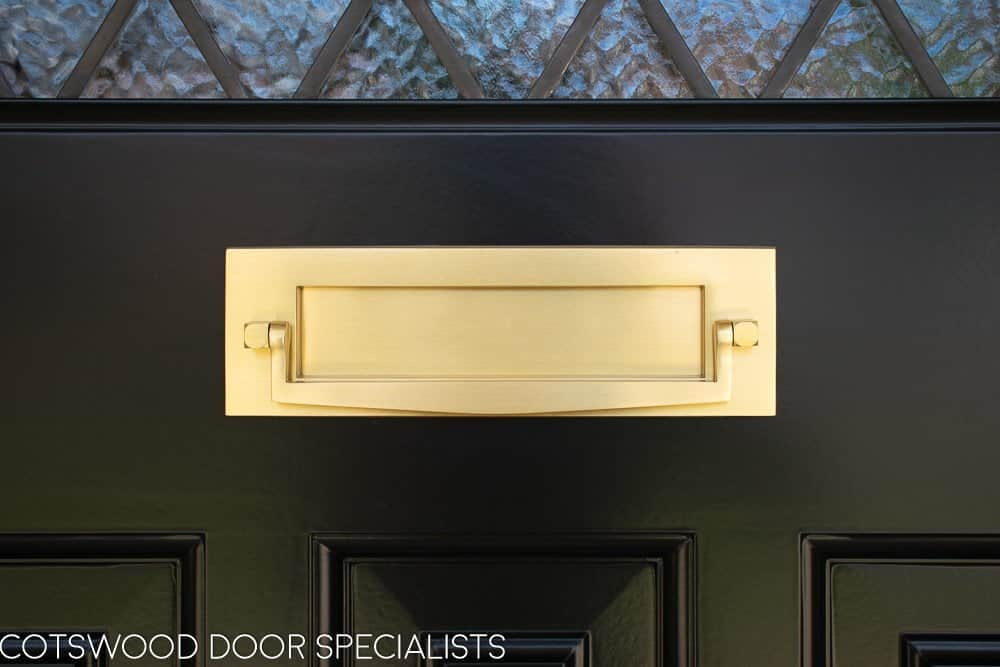 Satin brass door furniture lock in bespoke 1930s front door