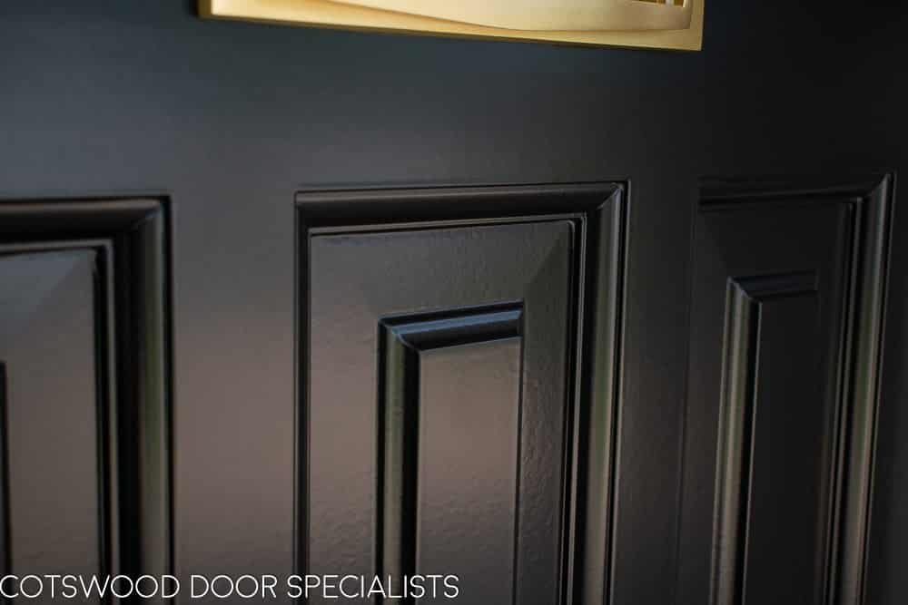 Raised door panel in bespoke black 1930s front door spray painted