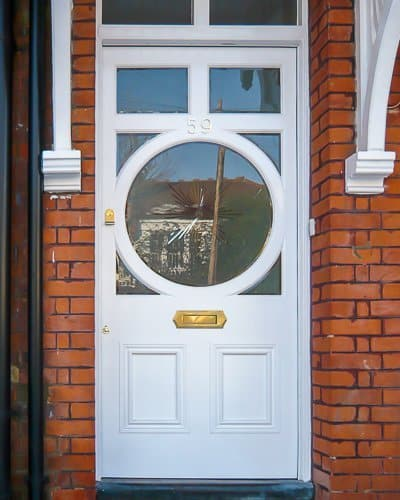Circular glazed Edwardian door. Sandblasted glass with brilliant cut clear star. Door painted white