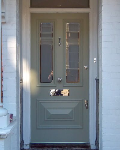 Double cricket bat paneled front door with etched glass painted light green