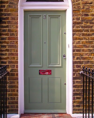 Early period Victorian front door painted light green