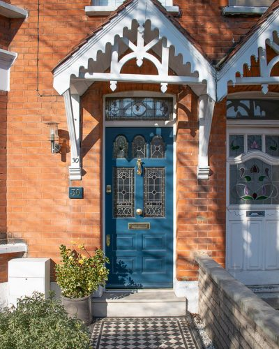 Edwardian five Light blue door. Bespoke door fitted with new frame and stained glass. Brass door furniture