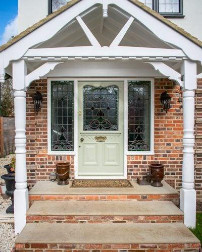 Edwardian front entrance door with stained glass. Decorative shaped glass in door antique door furniture. New door frame. Door and frame spray painted