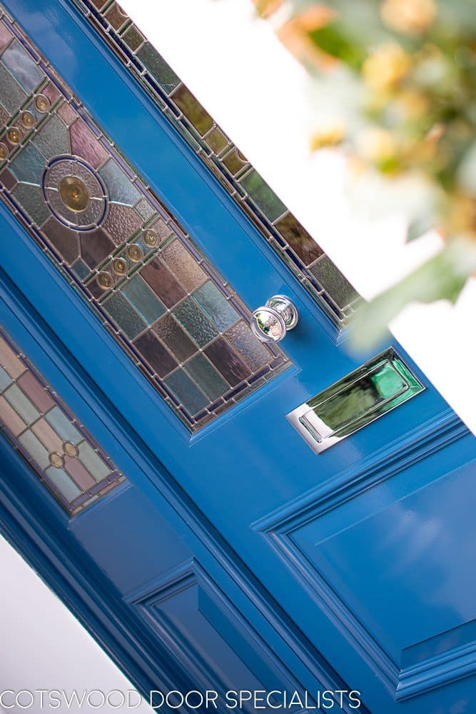 xtra wide Victorian front entrance door with double side panels. Painted dark blue