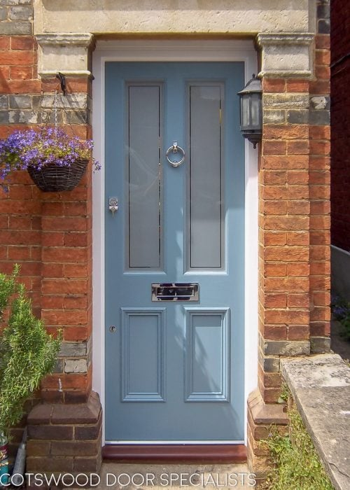 Four panel door with etched glass painted light blue