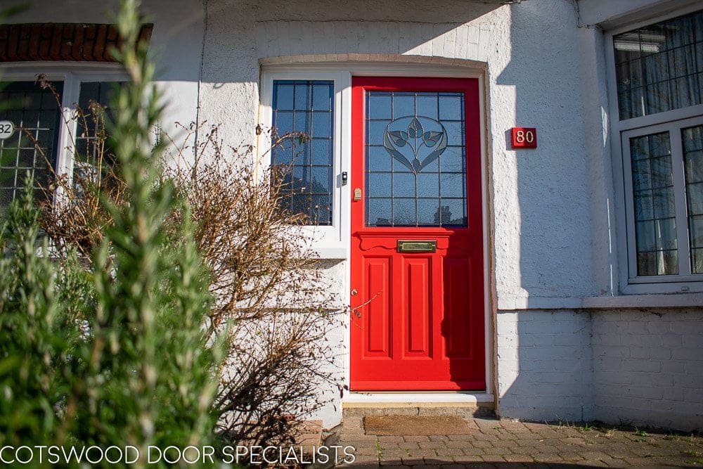 Late Edwardian red front door and sidelight frame. Door painted bright red. Stained glass in door and frame