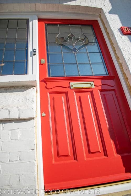 Late Edwardian red front door and sidelight frame. Door painted bright red. Stained glass in door and frame. Door panel details