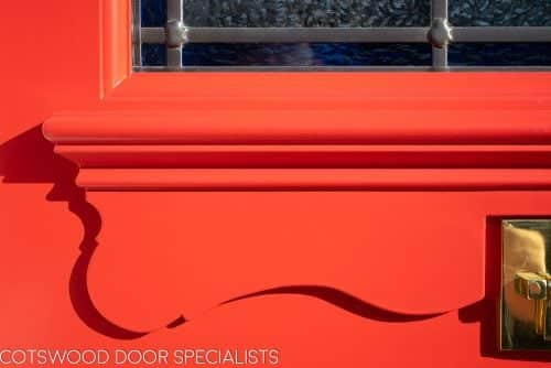 Late Edwardian red front door and sidelight frame. Door painted bright red. Stained glass in door and frame. Apron under door joinery moulding