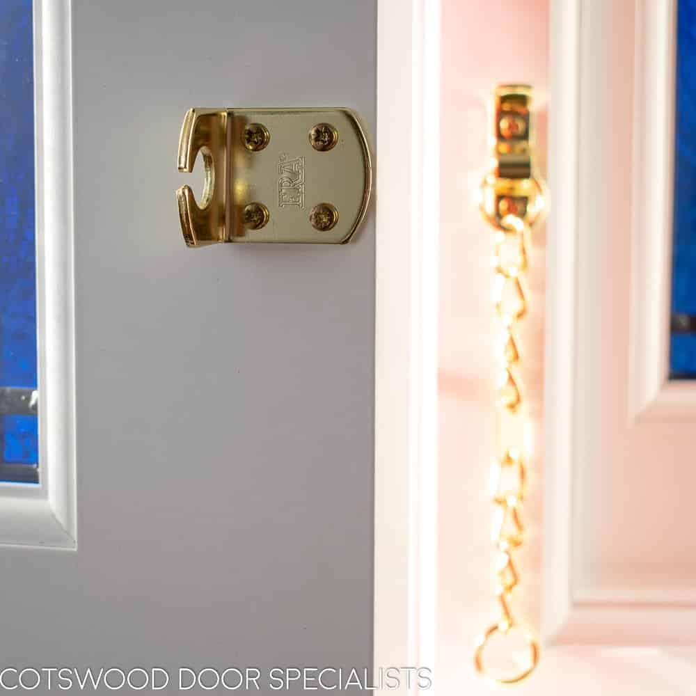 Late Edwardian red front door and sidelight frame. Shot from hallway of door locks and security