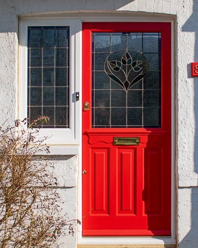 Late Edwardian red front door and sidelight frame. Door painted bright red