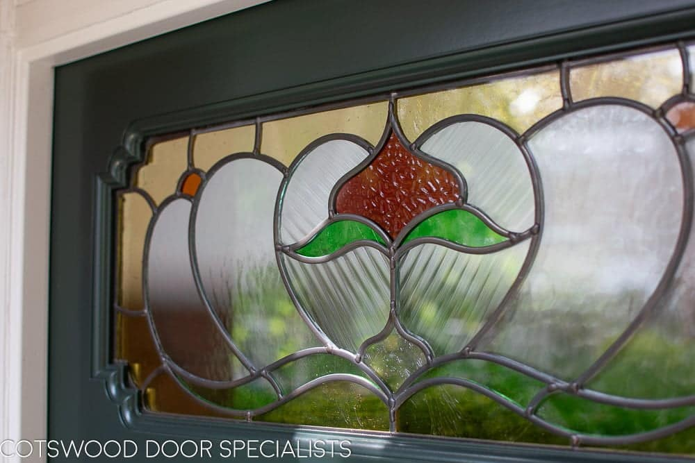 Ornate Edwardian front door stained glass. Door painted dark green