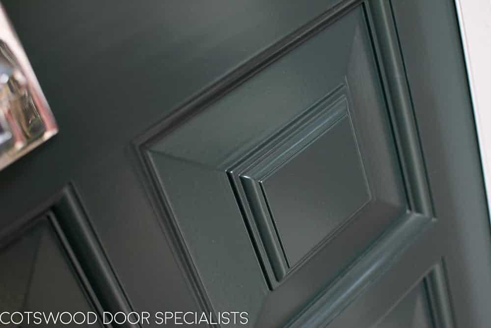 Ornate Edwardian front door stained glass. Door painted dark green. door panel