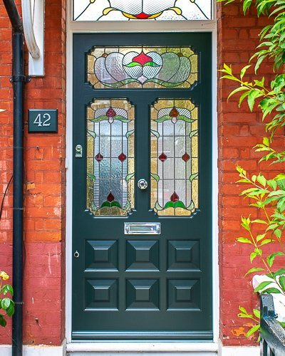 Ornate Edwardian front door stained glass. Door painted dark green