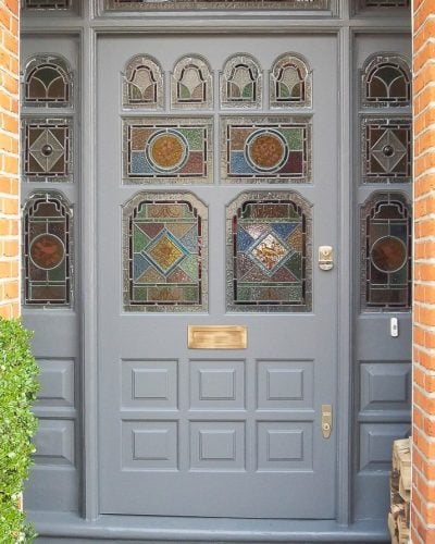 Ornate Victorian front door and frame with stained glass