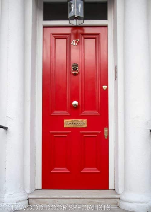 bright red Victorian London door with brass furniture