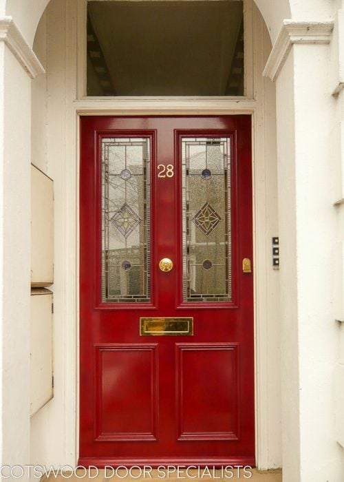 Red Victorian front door with leaded glass