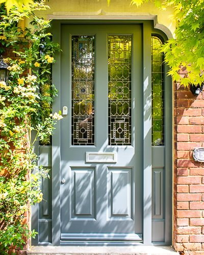 Victorian front entrance door with Gothic frame