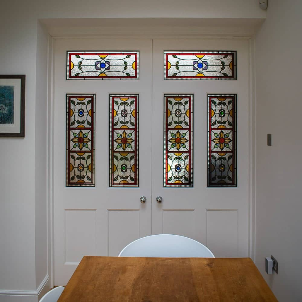 bespoke internal doors with stained glass. Doors painted white
