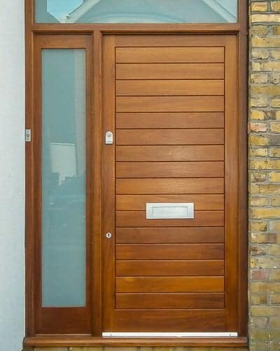 Dark wood contemporary front door and sidelight frame. Satin chrome door furniture. Etched glass