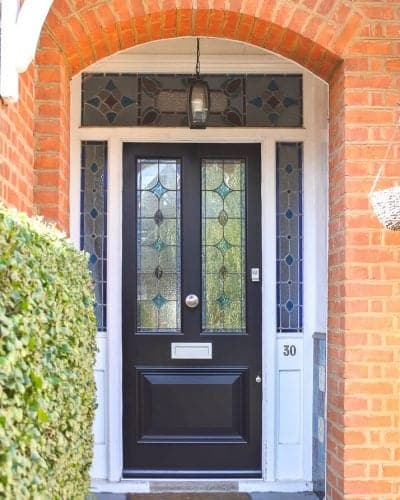 Late Victorian style dark blue painted front door. Door and frame with stained glass. Satin chrome door furniture