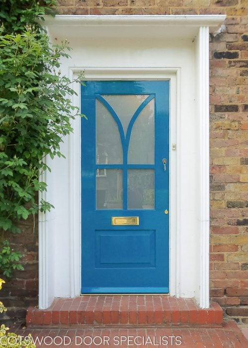 Modern painted wooden front door. Satin etched glass. Interesting wooden glazing bar. Unique modern front door design. Blue paint