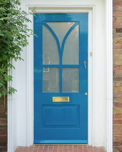 Modern painted wooden front door. Satin etched glass. Interesting wooden glazing bar. Unique modern front door design