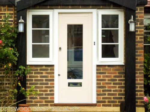 Spray painted contemporary front door with clear glass. Double glazed. Door with polished chrome door furniture