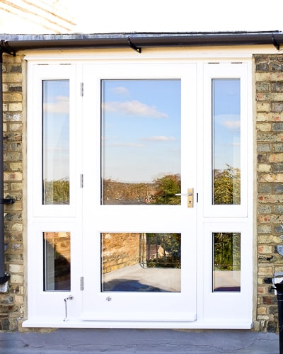 Balcony french door made in Accoya wood and painted white. Clear double glazed glass and satin chrome door fittings. Fitted into a London balcony