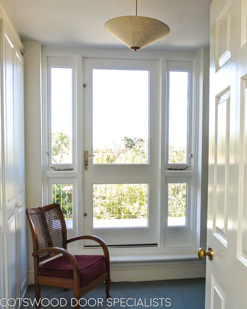 Balcony french door made in Accoya wood and painted white. Clear double glazed glass and satin chrome door fittings. Fitted into a London balcony, viewed from inside of house looking out
