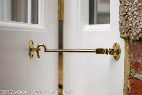 Brass cabin hook on wooden french doors