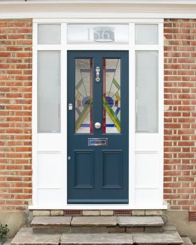 Art Deco front door and double sidelight fanlight frame. Beautiful dark blue painted door and frame painted white. Art Deco stained glass in the door and etched glass in the door frame. Polished chrome door furniture.
