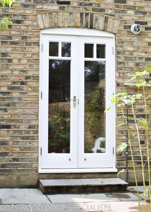 Victorian back door pair and new frame. Fitted into a Victorian terraced house with London stock brickwork. Doors fully double glazed incorporating a decorative wooden glazing bar. Polished Chrome door furniture and insurance approved deadlock.
