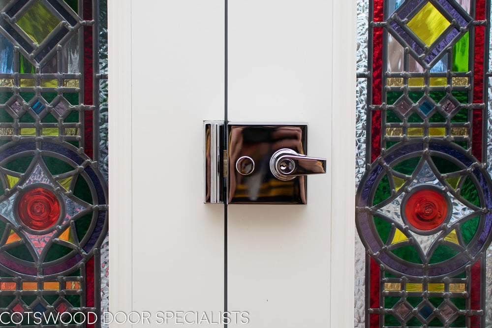 Victorian hallway stained glass front double doors. Closeup of security features