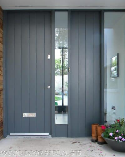 Dark Grey contemporary front door with sidelight and side panel. Simple clear double glazed unit. Satin chrome door furniture and fully spray painted.
