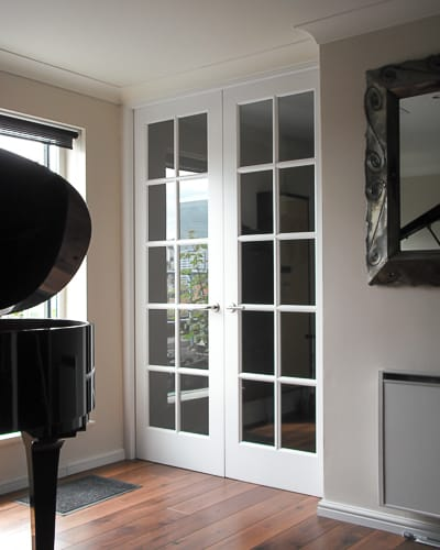 Georgian glazed internal doors with door frame. Extra tall doors painted white with clear glass. Double doors with narrow glazing bar
