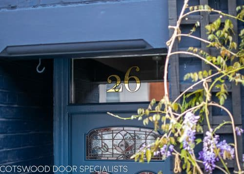 gold leaf door number above Victorian door