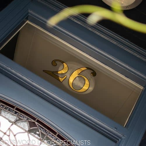 Gold ;leaf door number in victorian house