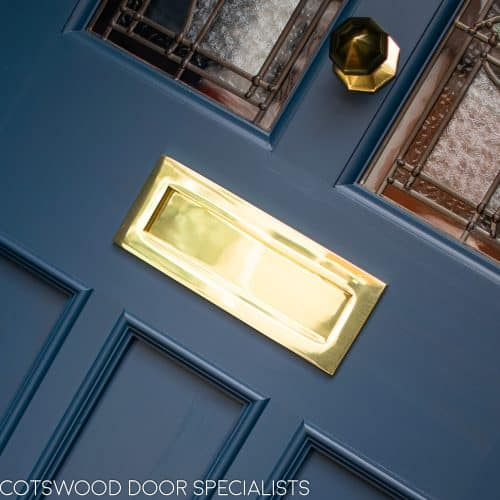polished brass letterplate to victorian door painted dark blue