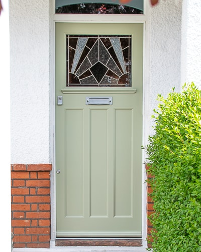 Stained glass 1930's Door. Stained glass with a geometric art deco pattern. Different colours of glass combined with different textures highlight the design. Door painted light green in colour. Satin chrome door fittings