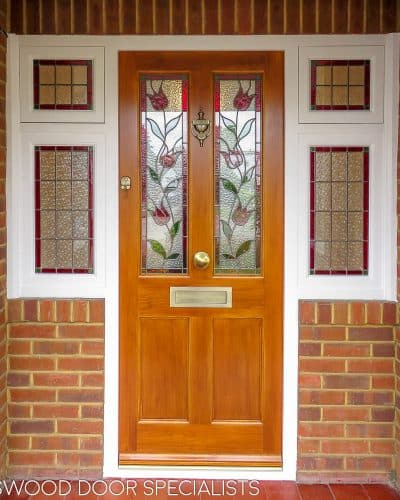 Victorian stained accoya door and sidelight window frame. Door light oak in colour. Door fitted with security multipoint lock. Antique brass door furniture, Opening side windows. Stained glass leaded double glazed units