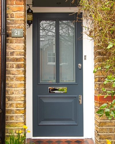 Slate grey Victorian style front door with etched glass. Fitted in a London home with yellow stock bricks. Polished Chrome door furniture. Bespoke door mouldings copying original ones.