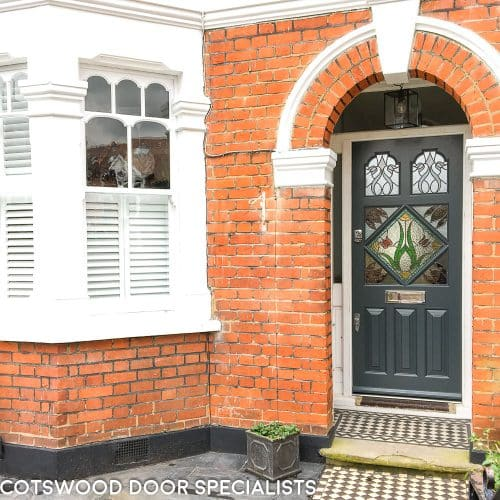 Edwardian front door painted slate grey with diamond stained glass and polished chrome furniture fitted into existing frame in London