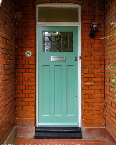 1920's Era front door with stained glass fitted into an existing door frame. Door has traditional features including stained glass. Simple mouldings to door. Painted light green in colour with satin chrome furniture.